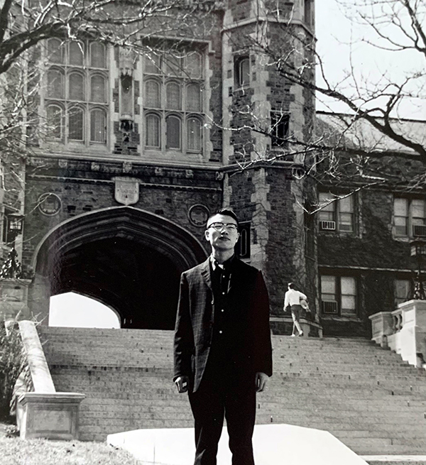 Ja Song in front of WashU's Brookings Hall